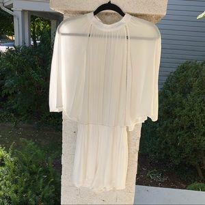 Honey Punch white romper with batwing sleeves